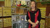 Н. А. Слепухина у книжной выставки к 90-летию Юрия Слепухина